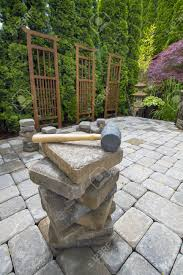 stack of cement pavers on backyard patio for garden landscaping