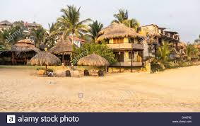evening light on palapa roofed rental units of rustic luxury hotel