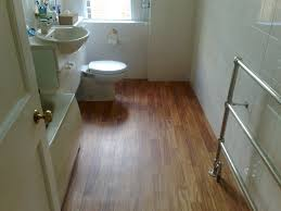 very small bathroom spaces with vinyl wood plank flooring