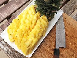 knife skills how to cut a pineapple like a badass serious eats