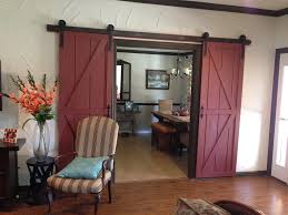 interior dark brown wooden sliding barn doors with black hardware