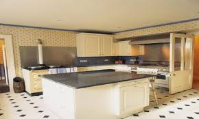 pictures of white kitchens with dark floors installing island