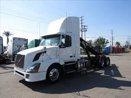 2009 volvo semi truck roll off trucks for sale