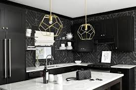 white cabinets with black countertops and backsplash 25 black kitchen ideas