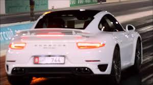 maserati gt vs porsche 911 2014 porsche 911 turbo 991 vs maserati ghibli yas marina drag