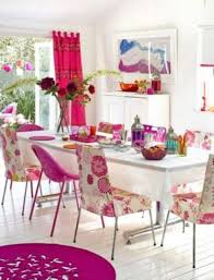 Red Dining Room Table by Floral Pink Upholstered Chairs White Wood Flooring White Cabinets