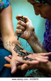 henna tattoo on the hand of a tourist place djemma el fna square