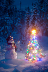 snowman stands in a snowcovered spruce forest next to a decorated