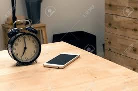 Desk Alarm Clock Smartphone And Black Vintage Retro Alarm Clock Times At 7 O U0027clock