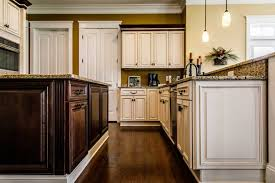 how to freshen up stained kitchen cabinets painted vs stained cabinets