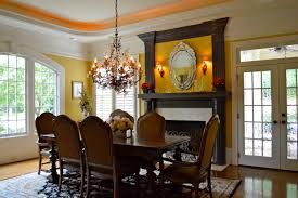 dining room with fireplace tampered glass french doors leading to