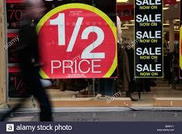 half price restaurant walking past half price sale signs in a shop window on a uk