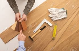 Laminate Flooring Baseboard Carpenter Showing Some Wooden Baseboard Swatches To A Customer