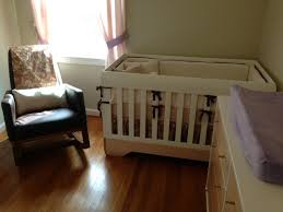 modern baby cribs nursery transitional with baseboard beige