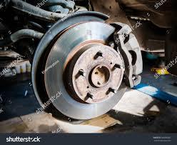 car suspension repair closeup disc brake vehicle repair stock photo 568080007 shutterstock