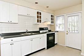 floor and decor granite countertops kitchen kitchen backsplashes with white cabinets black stove
