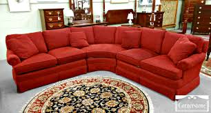 curved red velvet sectional sofa with square cushions and back