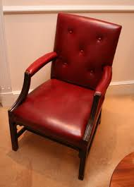 Wooden Frame Armchair Brown Wooden Frame Red Leather Padded Armchair On Reyooz Com