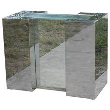 mirrored chrome desk console or dining table base in the style of