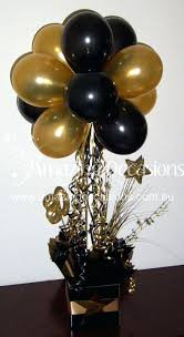 black and gold centerpieces for tables black and gold centerpieces gold centerpiece ideas gold and black