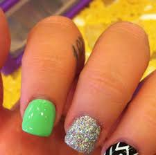 34 nail design with orange and green nails in pics