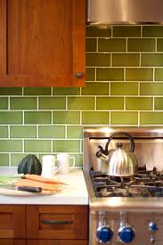 green tile kitchen backsplash backsplashes brown cabinet black knobs green gloss subway tile