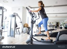 smiling training on stair stepper stock photo 642363460