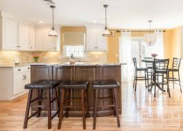 maple kitchen cabinets with white granite countertops bedford nh kitchen white cabinets with maple island