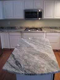 element mist glass 2 x 6 with fantasy brown granite kitchen