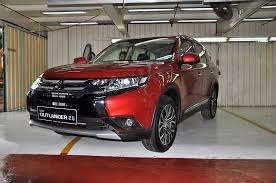 red mitsubishi outlander mitsubishi motors malaysia rolls out locally assembled outlander