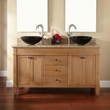 bathroom vessel sinks with brown wooden floor and double sink