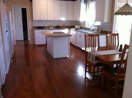 dark wood floors and light cabinets for floor arrangement