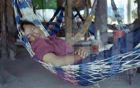 a man naps in a hammock during the afternoon ho chi minh city