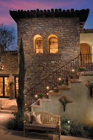 decor tuscan style homes with stairs and iron handrail plus night