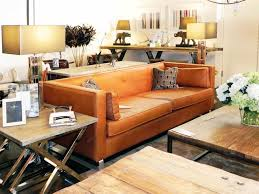 burnt orange coffee table this burnt orange leather sofa is the essence of casual chic