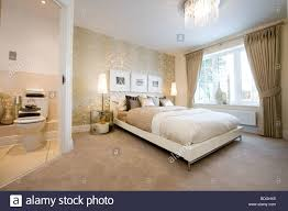 beautifully decorated bedroom with a double bed and ensuite