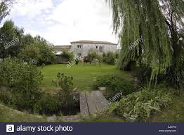 garden land grass green cottage house home exterior outside
