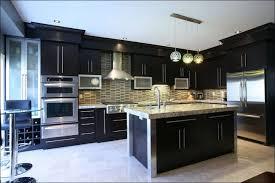 kitchen white cabinets black appliances grey granite countertops