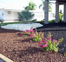 light brown and black rubber mulch with white stone for awesome