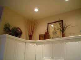 above kitchen cabinet decor ideas above kitchen cabinet decorating ideas best home decorating