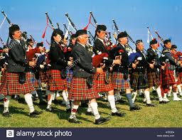 scottish pipers blowing bagpipes scotland united kingdom great