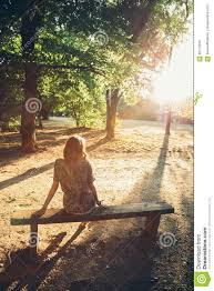 sitting on a park bench stock photo image 68713559