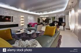 fluorescent ceiling and wall lighting in large open plan apartment