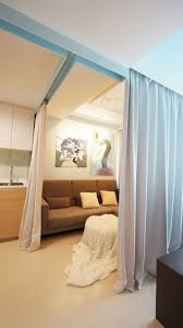 tiny apartment uses fabric curtains to divide its spaces tiny apartment singapore living area curtains