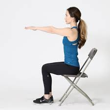 Sitting On A Medicine Ball At Desk The Ultimate U0027deskercise U0027 Routine Stretches For The Office