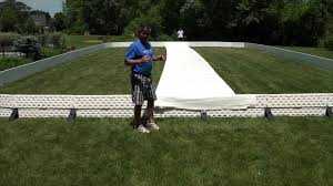 Backyard Ice Rink Kits by How To Roll Out And Unfold Your Liner For Your Backyard Ice Rink