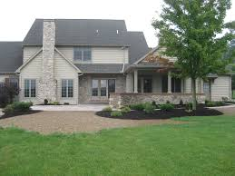house with a wrap around porch new homes middle creek builders