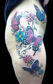 collection of 25 butterflies tattoos on thigh