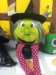 inspiring witch green pumpkin with hat and hair of pumpkin