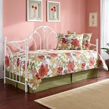 beautiful functional white metal daybed as sleeping area in the